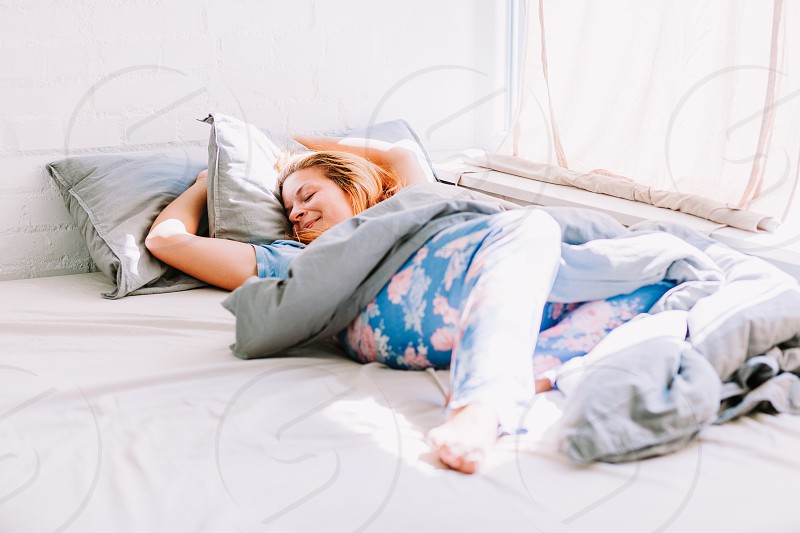 Young woman sleeping in the bed in the morning photo