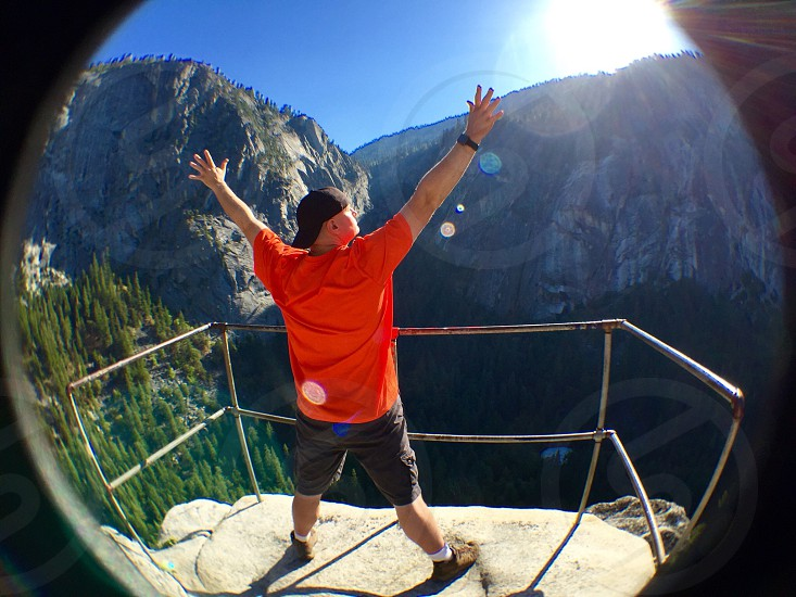 Reading the top of Sierra Point in Yosemite National Park this millennial celebrates. photo