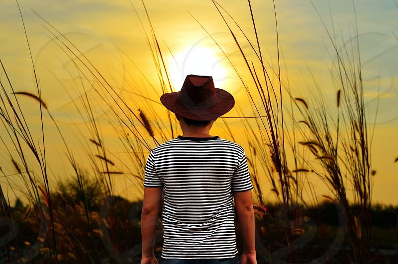 man watching sunset  photo