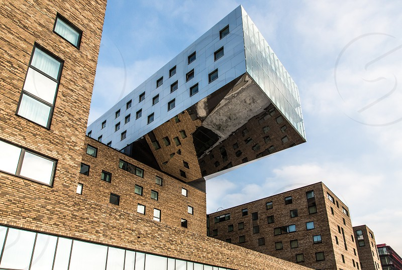 building brick steel reflection sky architecture window hotel photo