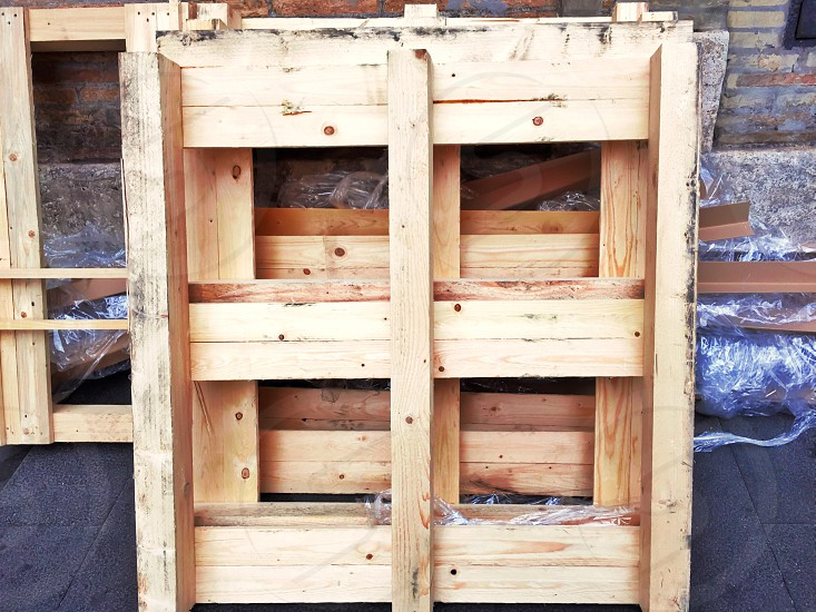 Dirty wooden pallets left on the wall. Construction and industrial transport photo
