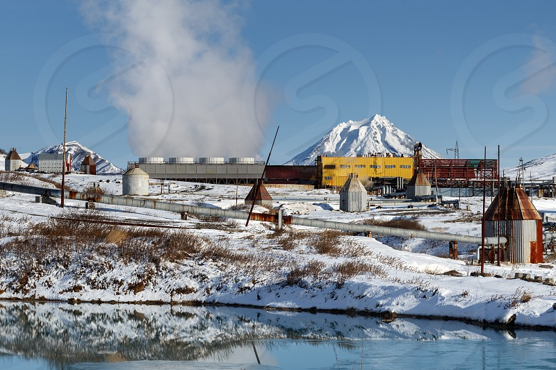 KAMCHATKA PENINSULA RUSSIAN FAR EAST - OCT 22 2017: Mutnovskaya Industrial Geothermal Power Plant generating electricity for Petropavlovsk-Kamchatsky City and other settlements of Kamchatka Region. photo