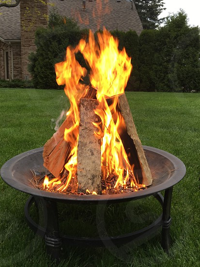 round black fire pit with bonfire photo