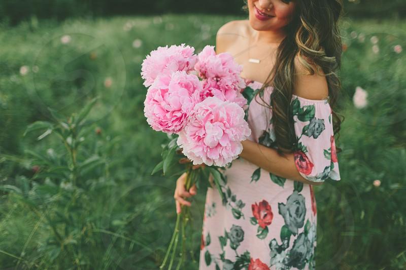 A beautiful woman in a peony field.  photo