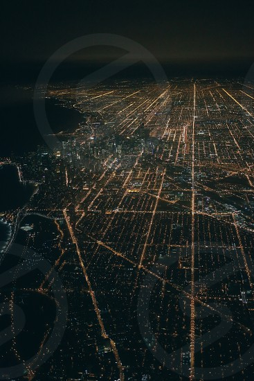aerial view of a city at night time photo