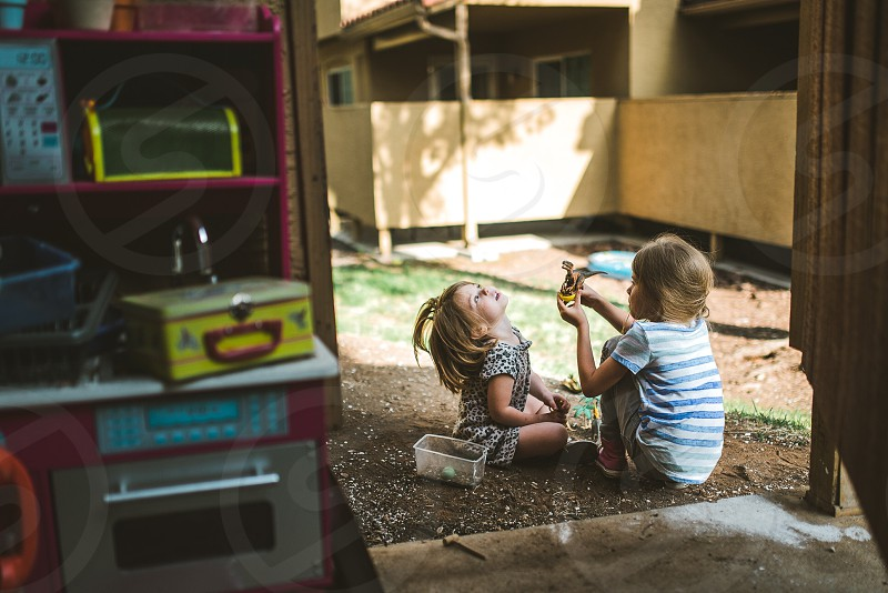 Kids home outside playing dirt lifestyle girls photo