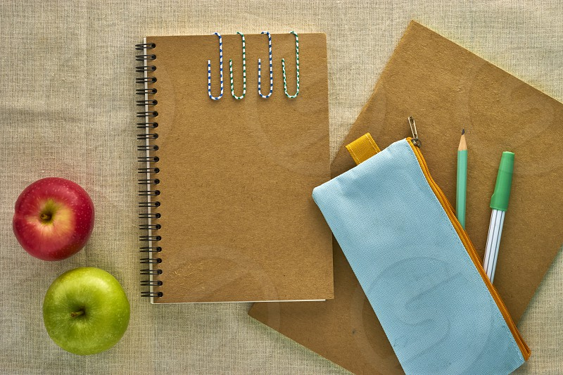 Recycled paper notebook School supplies on Natural Linen photo