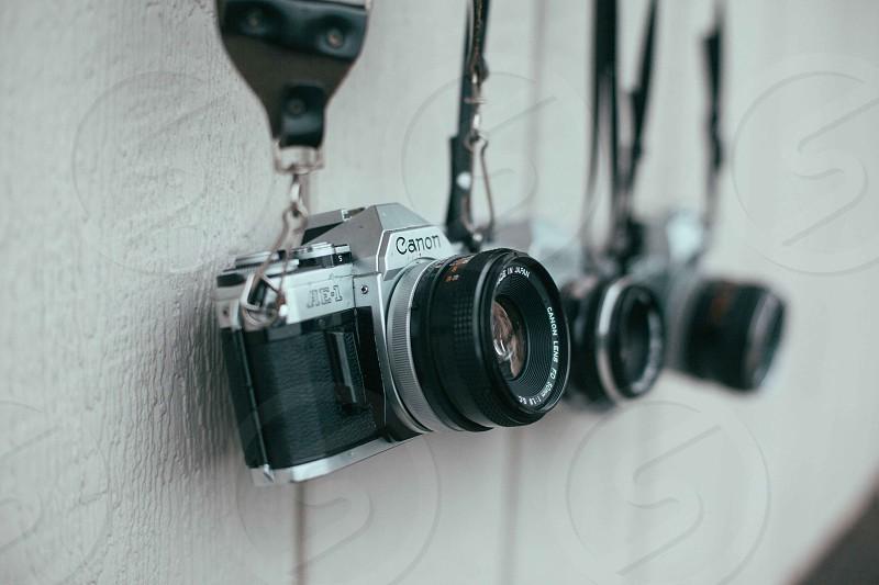 hanging canon cameras photo