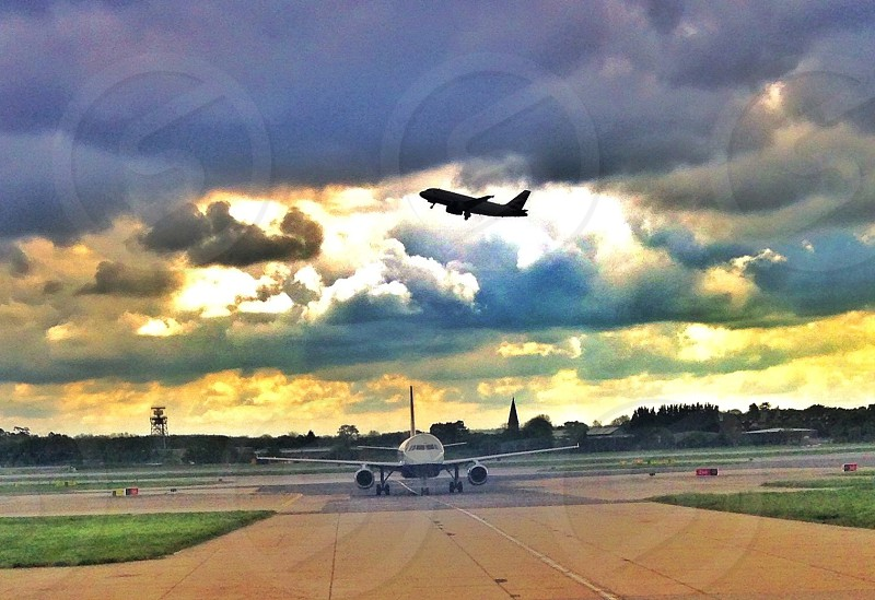 Plane runway aeroplane silhouette take off taxiing clouds travel photo