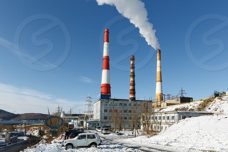 PETROPAVLOVSK-KAMCHATSKY KAMCHATKA RUSSIA - NOVEMBER 15 2014: View on Kamchatka thermoelectric power station with smoking pipes. Kamchatka CHP-1 JSC Kamchatskenergo RAO Energy System of East. photo