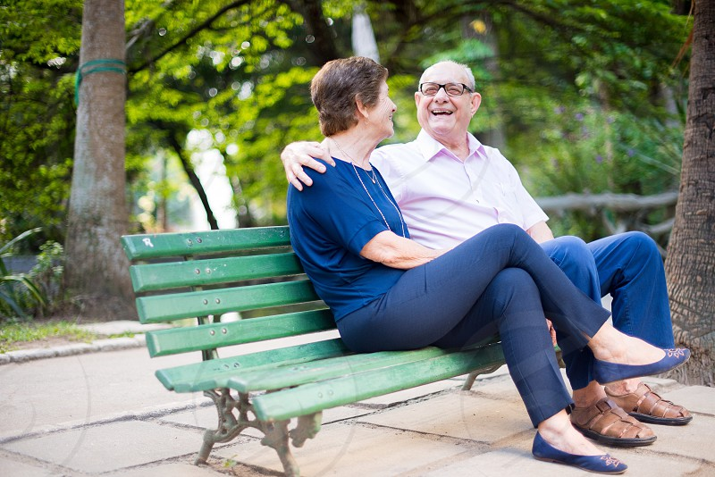 Cute old couple having fun and laughing at the park photo