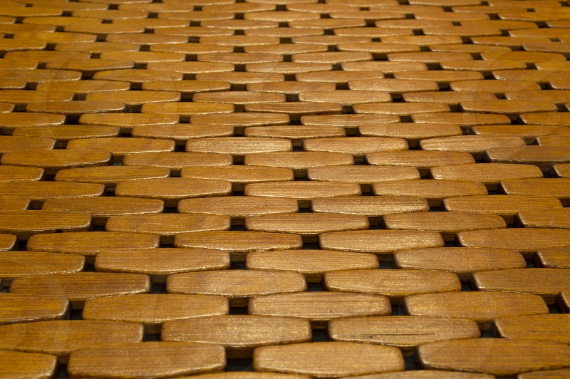 Wooden tile pattern in a floor mat viewed from a low angle so the tiles are horizontal to the viewer. photo