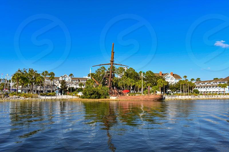 Orlando Florida. February 09 2019 Partial view of Pirate Ship and Village Hotel at Lake Buena Vista area (1) photo
