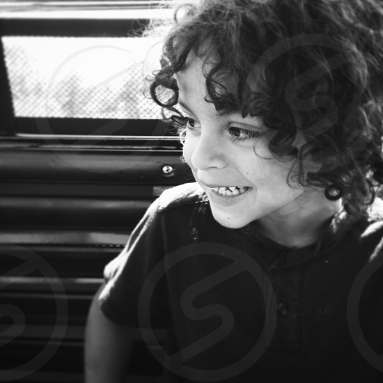 boy curls with smile photo
