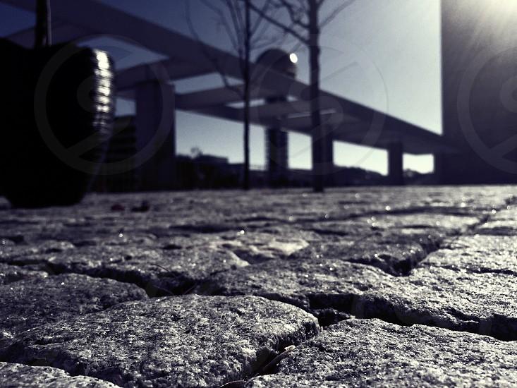 black vase on stone pathway and white bridge photo