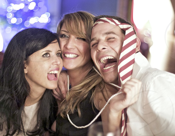 man and 2 women laughing photo