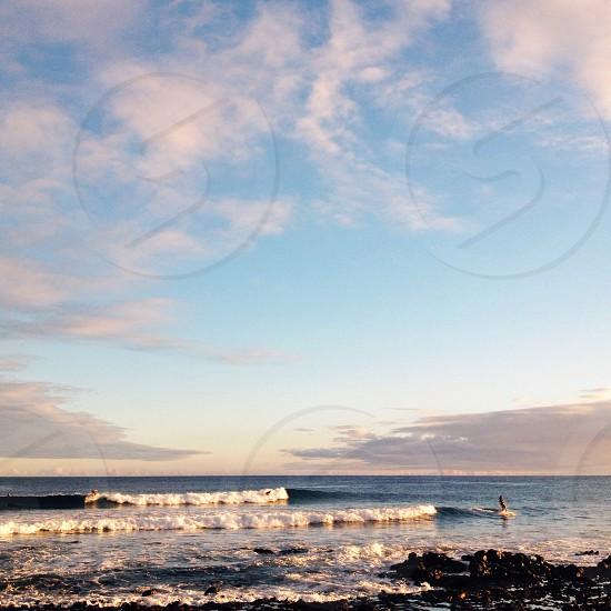 Hawaiian sunset surfing session photo