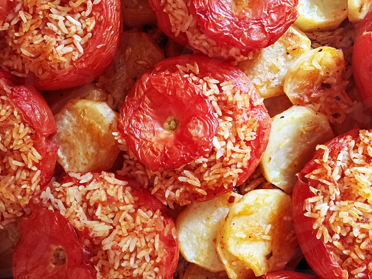 baked tomatoes with rice and potatoes. Typical recipe of the Roman culinary tradition. Italian food photo