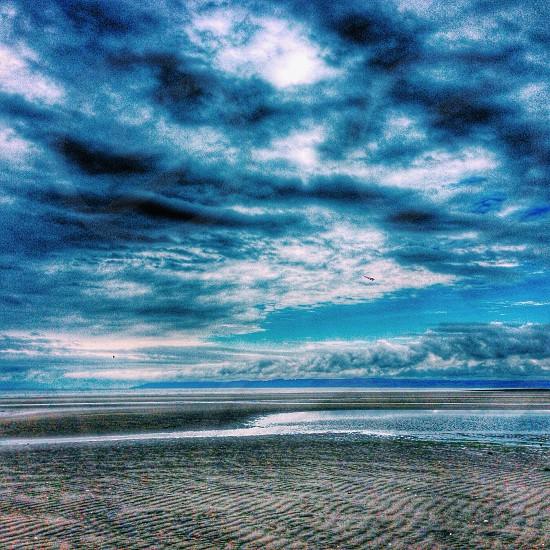 cloudy sky over emptybeach photo