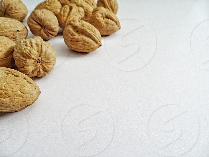 healthy nuts healthy lifestylewalnutsfood healthy foodnutsbowlwhite backgroundcopy spaceroom for text photo