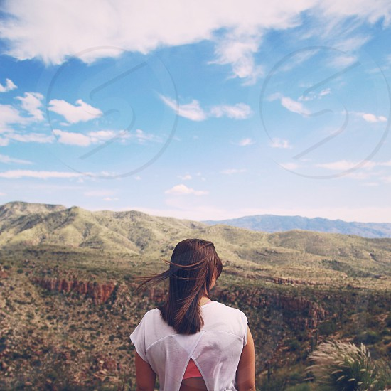 Girl looking out from a mountain top view in Arizona. Windy hair girl portrait AZ Tucson Arizona Travel photo