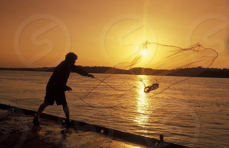 a fishing men at the river Danube in the city of Ruse on the border to romania in Bulgaria in east Europe. photo