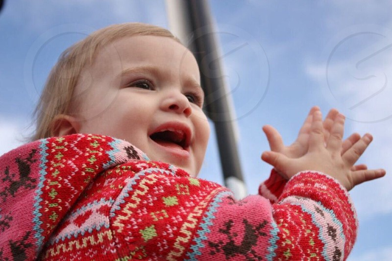 Baby clapping. Happy baby.  photo