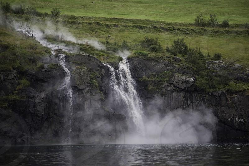 A hot spring waterfall in Akureyri Iceland photo