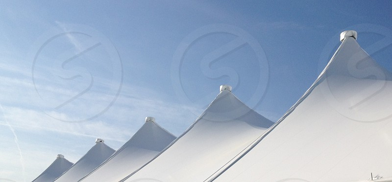 white pyramid shaped tent photo