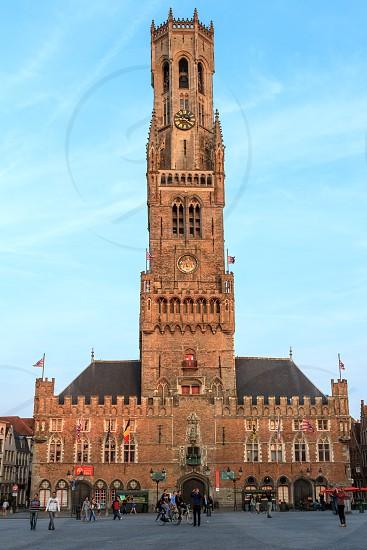 Belfry of Bruges in Bruges at around sunset Belgium photo