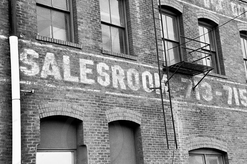 salesroom 713-715 text on bricked wall exterior photo