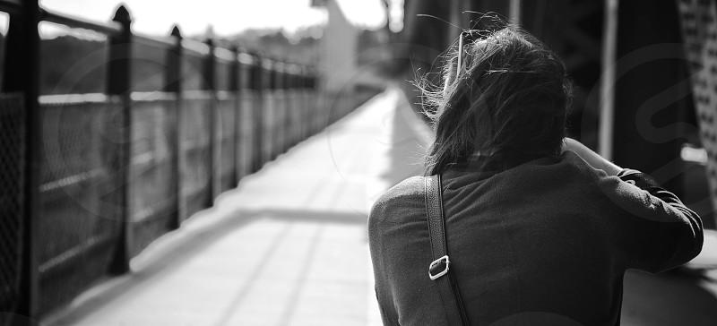 woman standing near railings photo