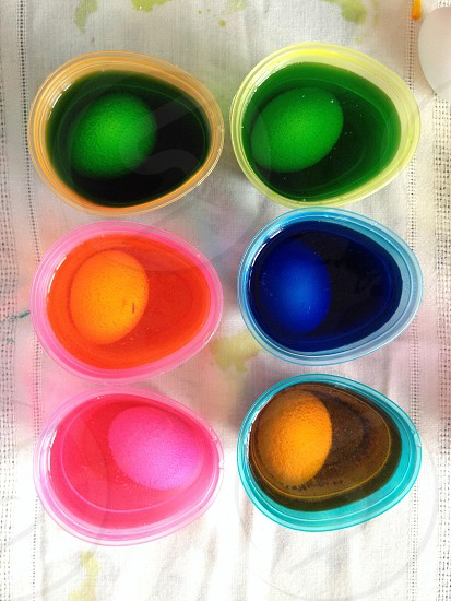 green blue pink and yellow easter eggs view photo