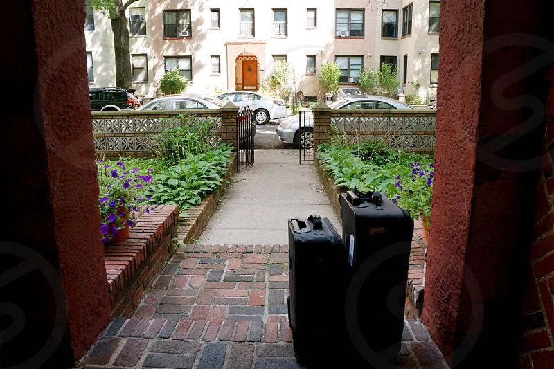 pair of black luggage outside photo