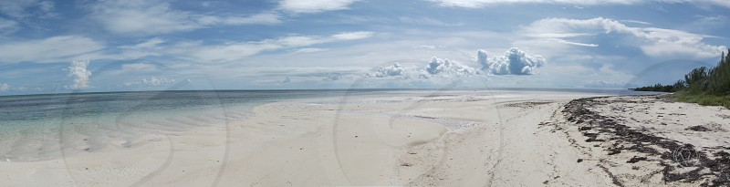 Panaromic image of Cast Away Cay beach in the Caribbean photo