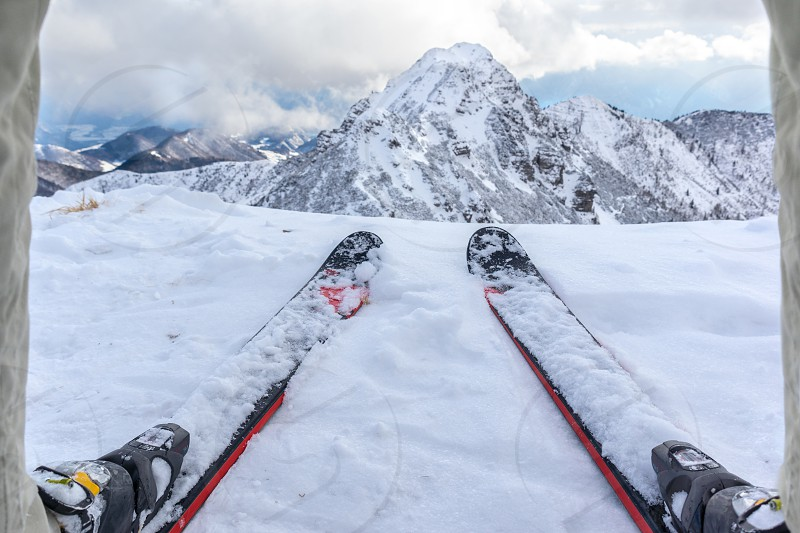 different perspective view from skier on surrounding mountains photo