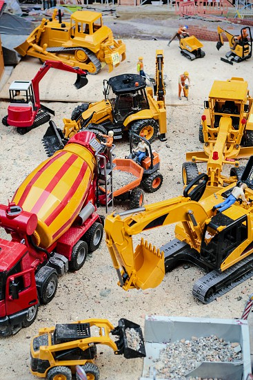 The building yard in toy version there are the crane and crawlers work photo
