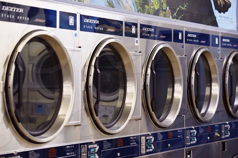 blue and silver dexter front load washing machines photo
