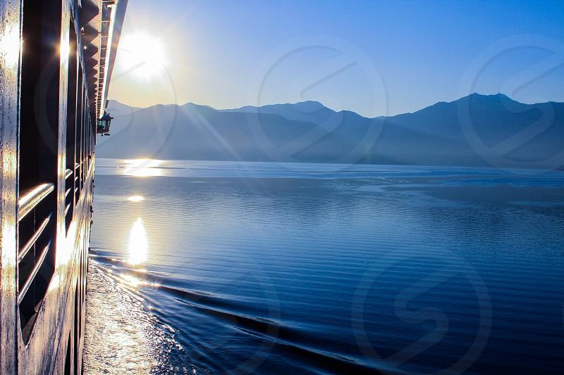 Cruises through the glass like waters of Kotor Montenegro. photo