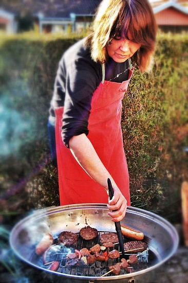 woman cooking a pork barbecue photo