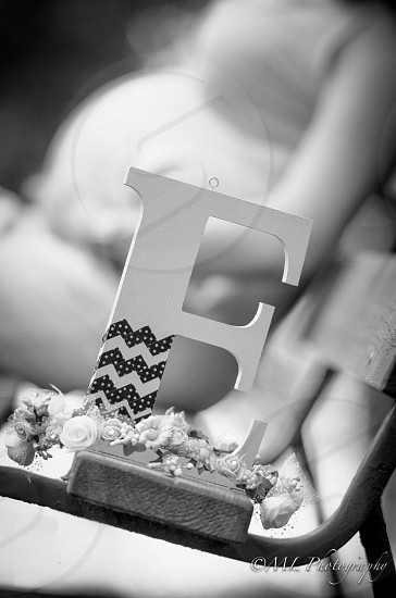 grayscale photo of E cutout letter photo