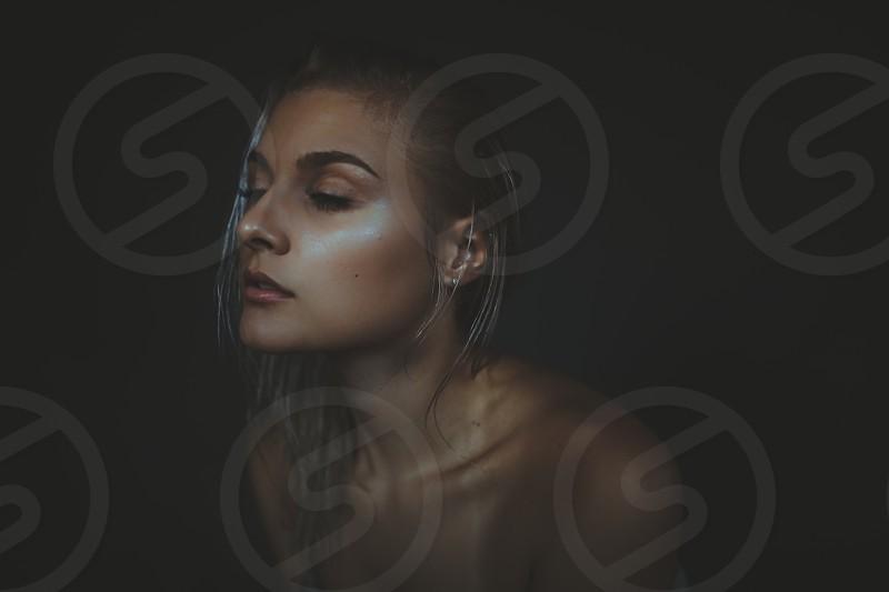 dewy makeup girl stillness candid studio lighting soft model gray hair wet dark moody  photo