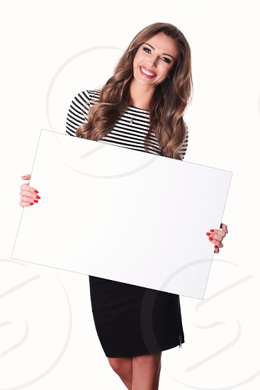 Beauty brunette on white background. photo