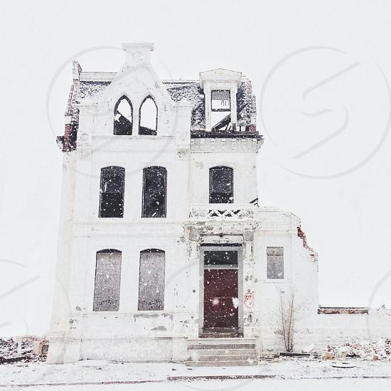 white 3 story house photo