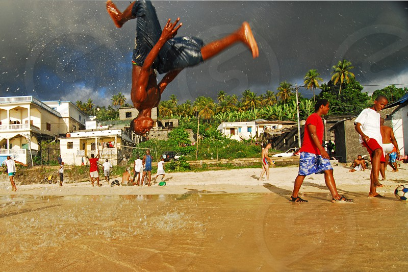 Spectacular upside down jump by african adolescents on the beach Moroni Grande Comores Comoros photo