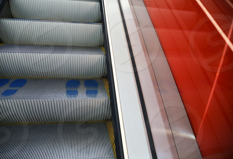 Stair stairs step steps colorful shoe mark  shoe marks  orange colors bright escalator tube blue up photo