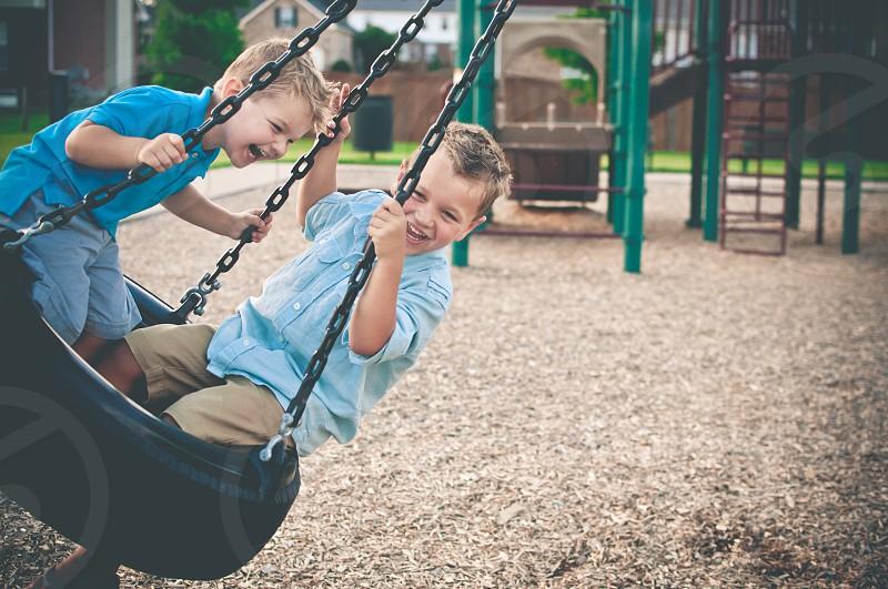 swinging boys brothers children childhood photo