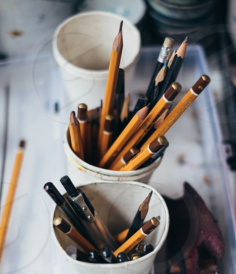 pencils and brushes in the studio photo