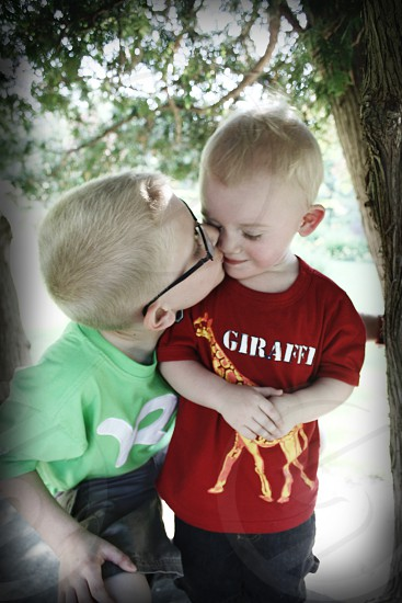 Loving baby brother.  photo