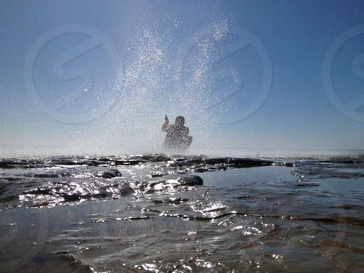 person splashing in water photo